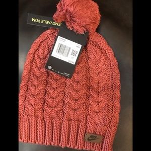 Nike knit hat with removable pom. NWT